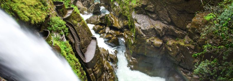 waterfall and stairs at pailon del diablo waterfall in baños ecuador