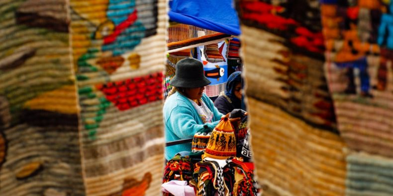 brightly colored textiles in otavalo marketplace