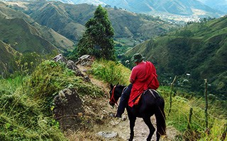 Vilcabamba Ecuador man on horse on hill