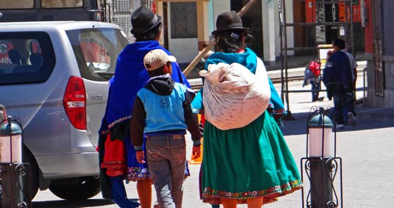 Women in traditional clothes walking in Alausí, Ecuador