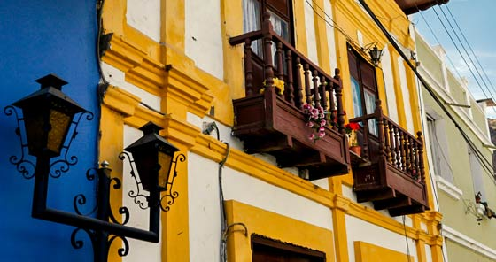 Yellow colonial building with wooden balcony in Alausí, Ecuador