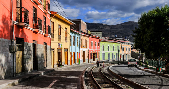 Twentieth century colorful buildings along railway tracks in Alausí, Ecuador