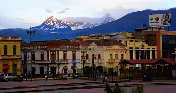 Colonial houses at Riobamba train station with Chimborazo volcano in background
