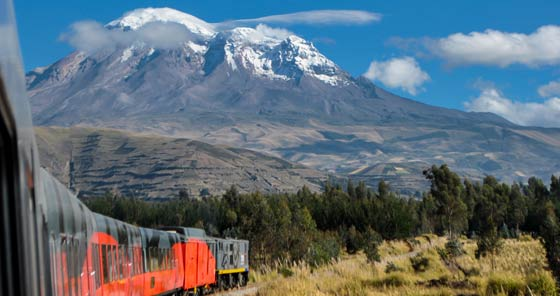 Train with Chimborazo Volcano in background in Riobamba